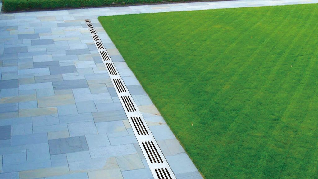 Alusthetic Threshold Drain Installed With Grey Aluminium Grating In Rear Grass Garden